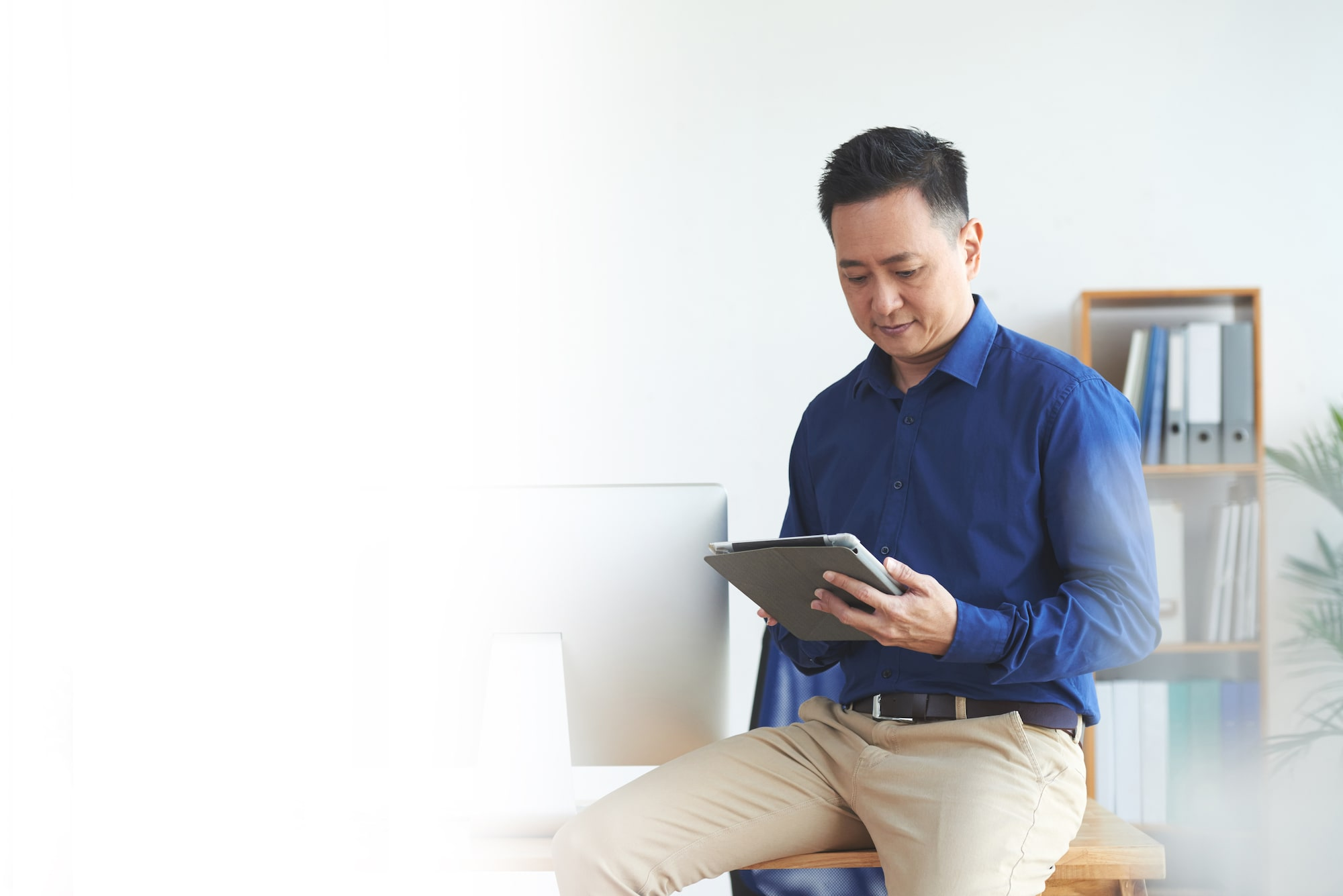 Asian man singapore tablet